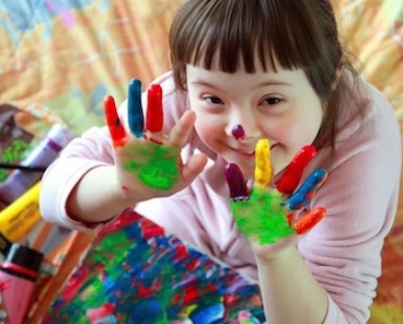 stock photo girl with paint on hands